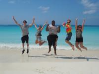 Students jumping on the beach
