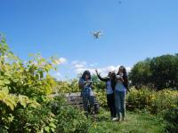Students outside flying drone